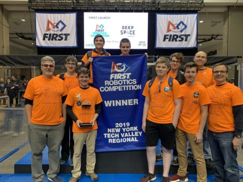 Team Members Holding 2019 Tech Valley Regional 1st Place Trophy